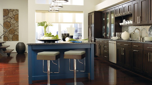 23. DARK WOOD CABINETS WITH A BLUE KITCHEN ISLAND