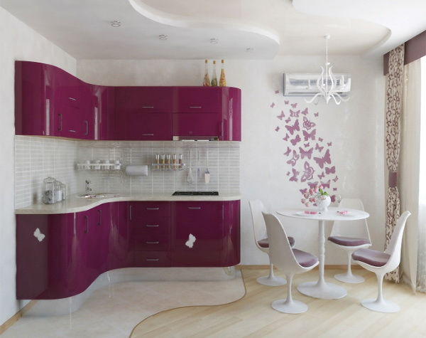 25. PINK KITCHEN WITH A SMALL ROUNDED EAT-IN TABLE