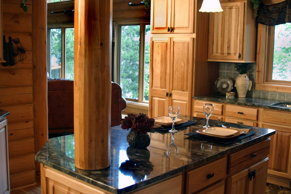 27. Wooden Styled Kitchen With Marble Top Finish