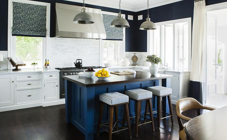 28. BLUE KITCHEN ISLAND WITH WOODEN COUNTERTOPS AND A TOUCH OF BLACK