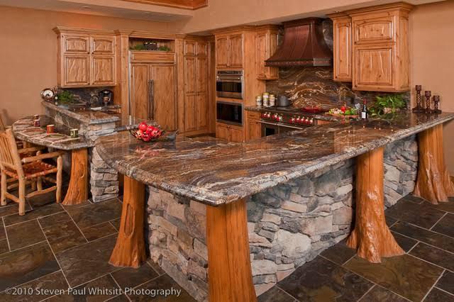29. Granite Peninsula With Wooden Detailing