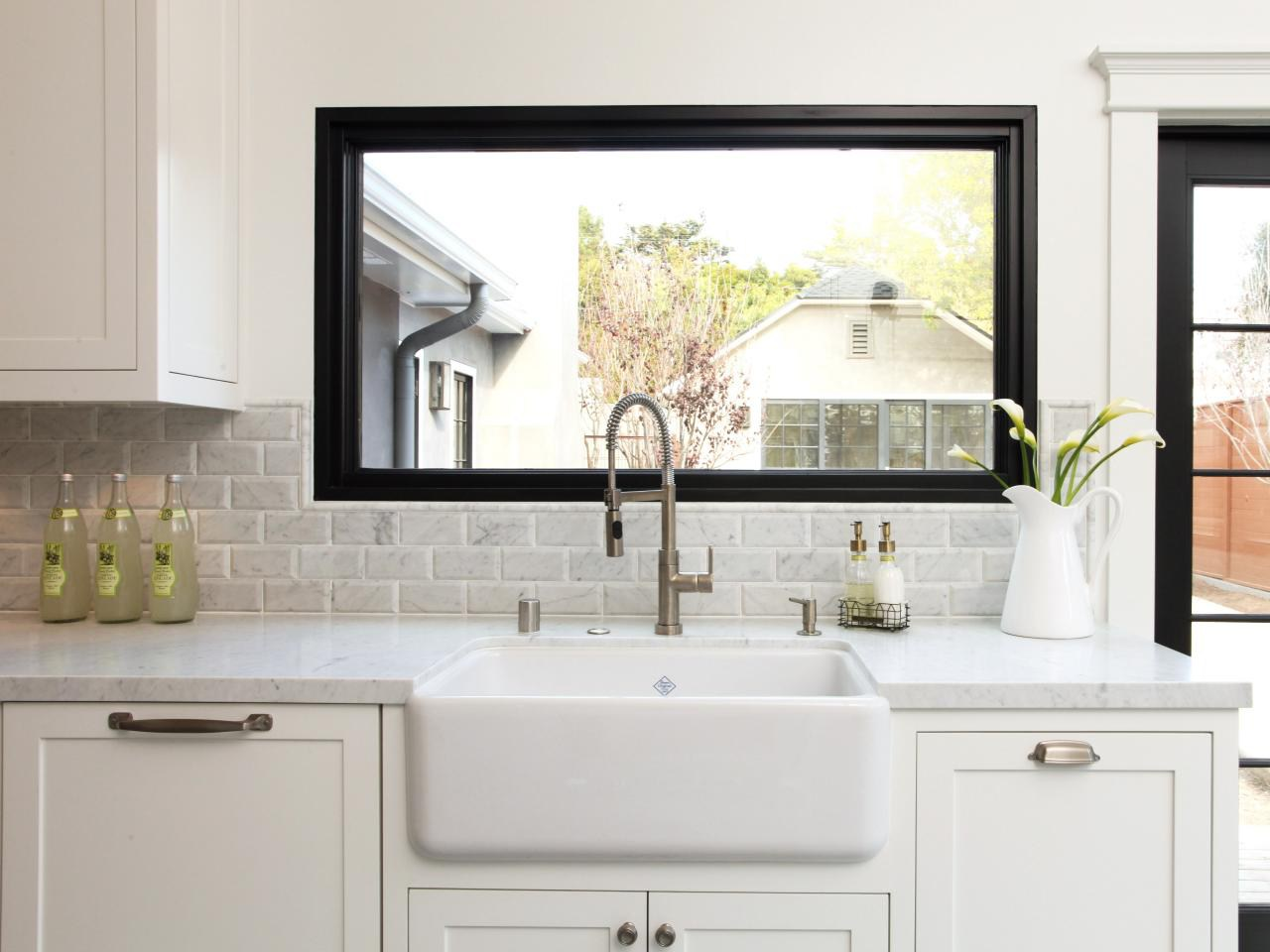 3. Black and White Kitchen With Organised Soap Dispensers