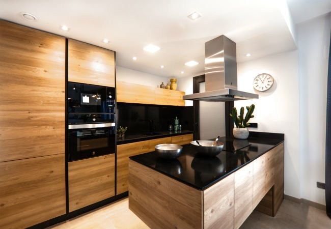 7. Contemporary Black Top Kitchen Peninsula With Glossy Finish