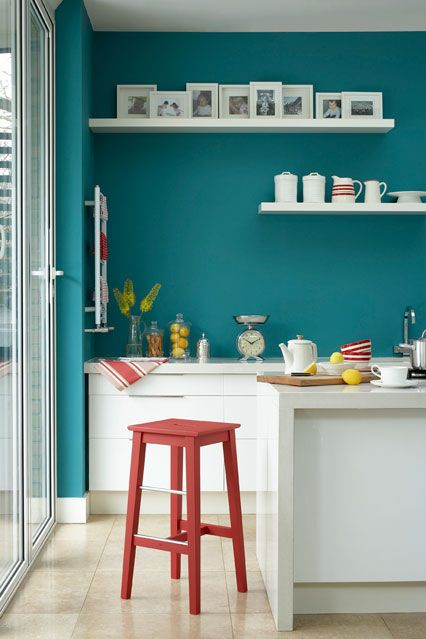 10. White Cabinets, Teal Walls