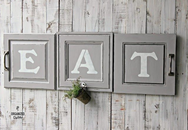 12. Wall Sign Decor With Old Cabinet Doors