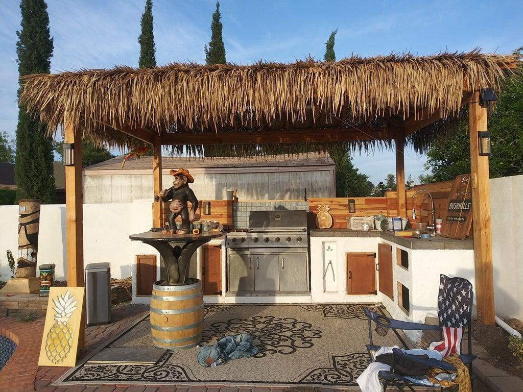 14. DIY Palapa Tiki Hut With Outdoor Kitchen