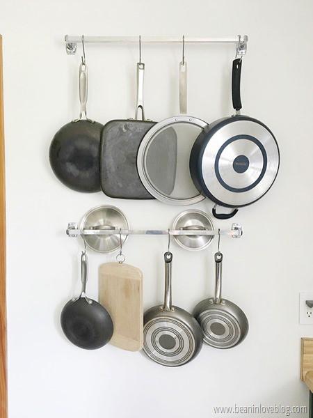 15. Towel Bar Pot Rack DIY