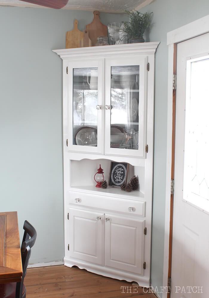 2. White Corner Storage Cabinet