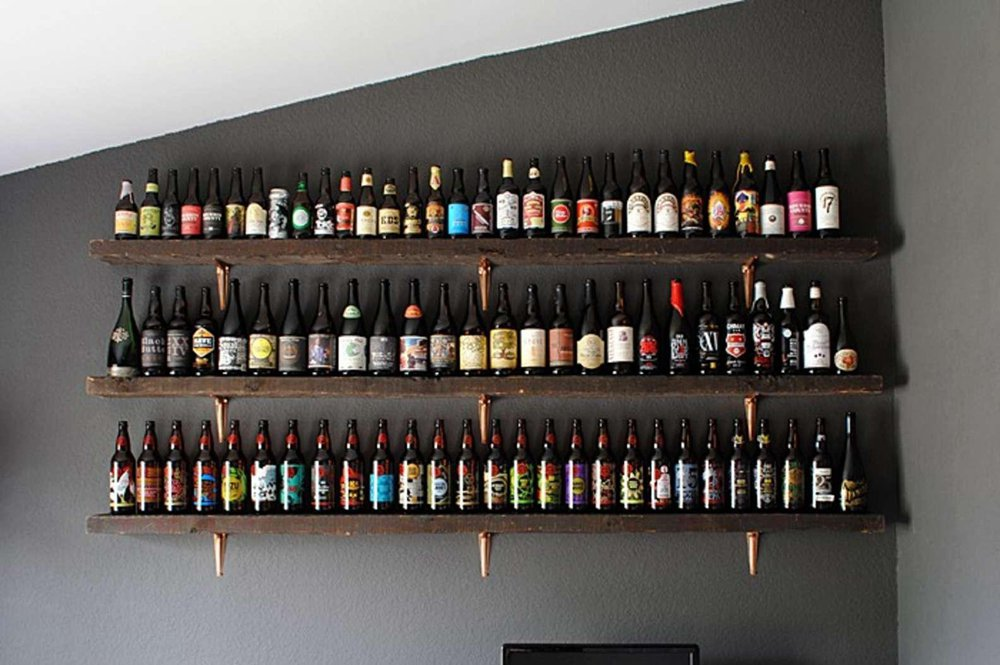 24. DIY Rustic Wine Shelves