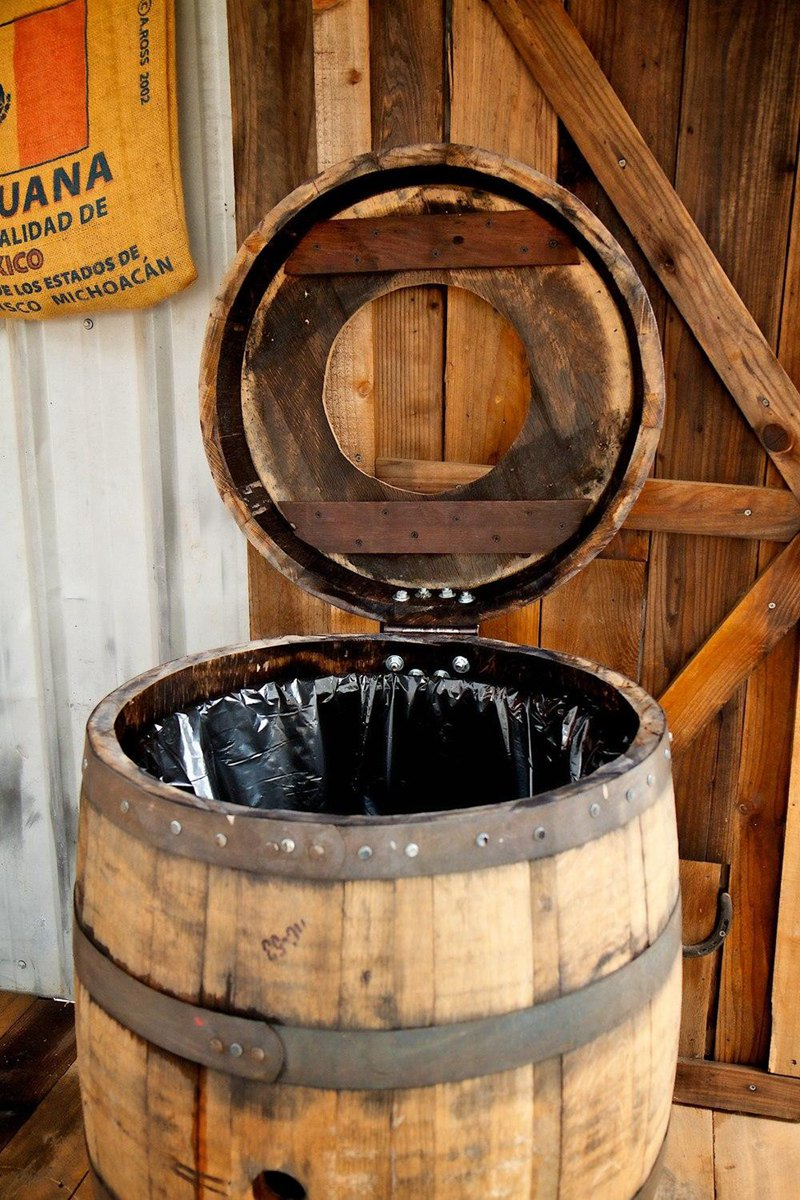 26. Barrel Trash Can Storage