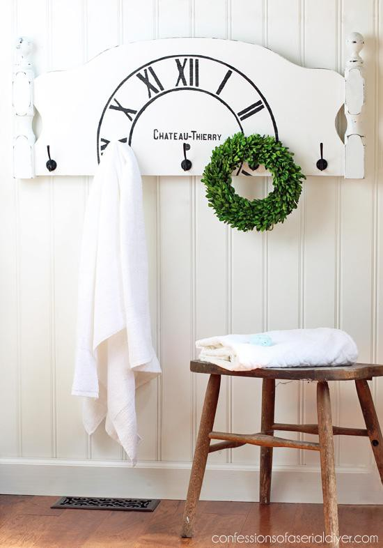 20. Repurposed Headboard Towel Rack