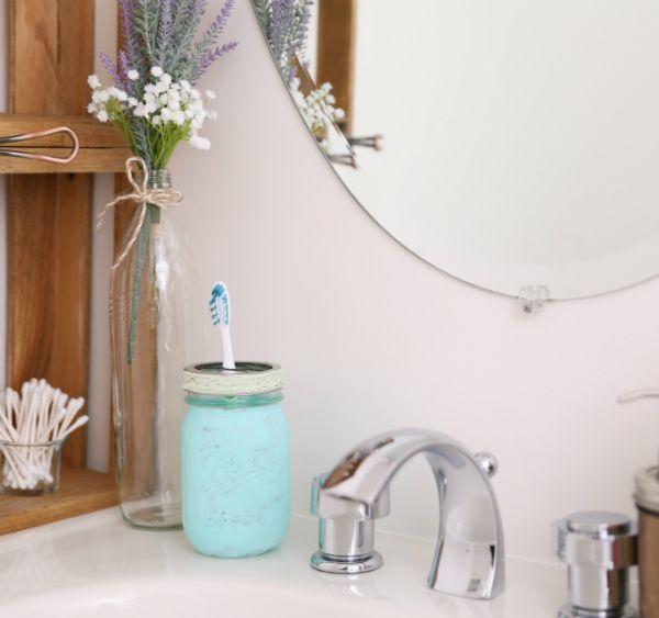 24. Painted Mason Jar Toothbrush Holder DIY