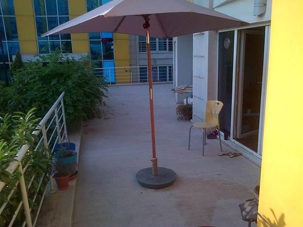 9. DIY Concrete Umbrella Stand