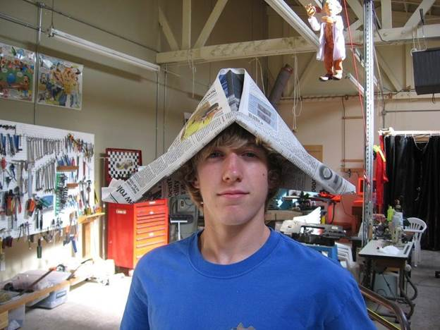 12. DIY Newspaper Hat