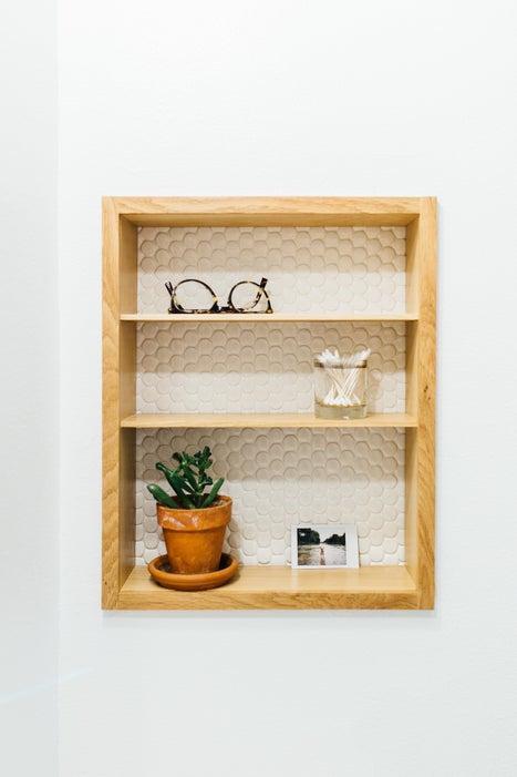 1. DIY Recessed Bathroom Shelves