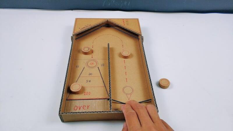 13. DIY Desktop Shuffleboard Table With Cardboard