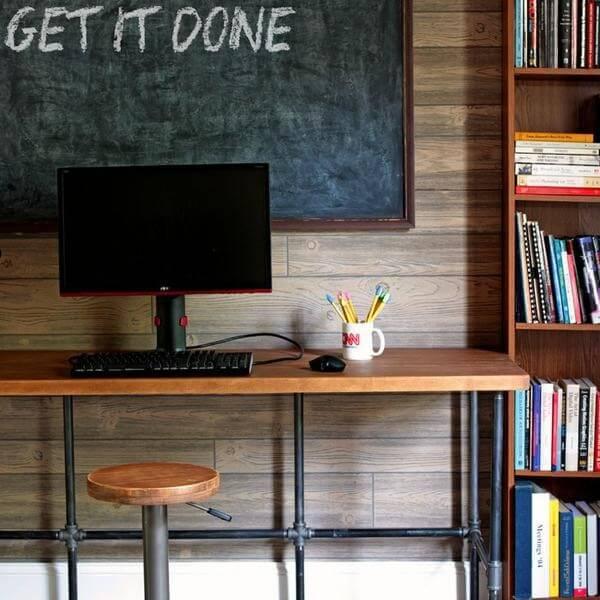 13. DIY Pipe And Wood Desk