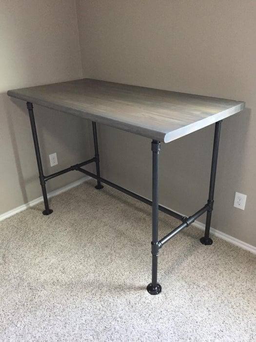 15. DIY Black Pipe Standing Desk