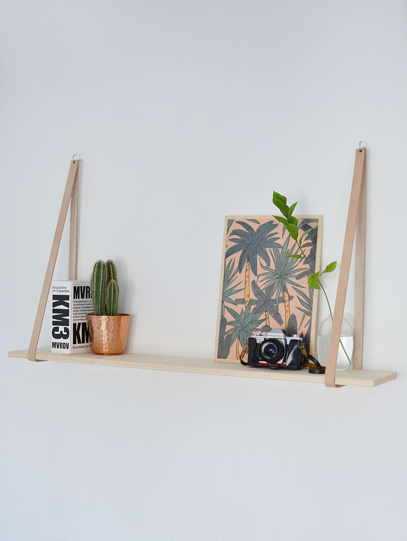 17. DIY Easy Leather Strap Hanging Shelf