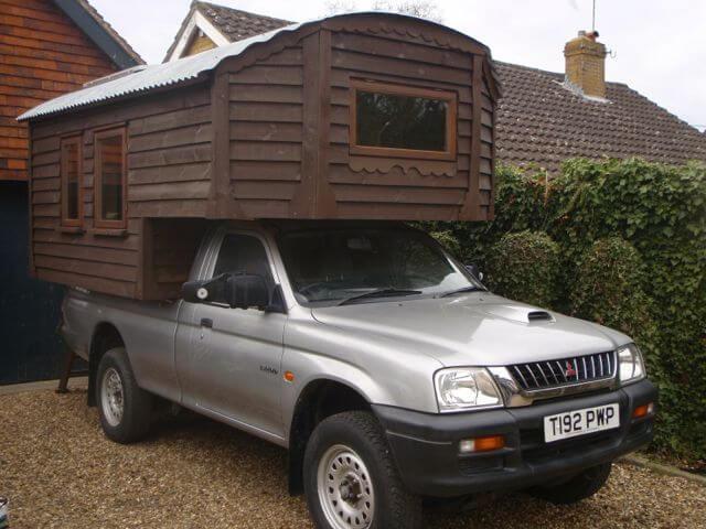 7. A homemade truck camper that is a work of art