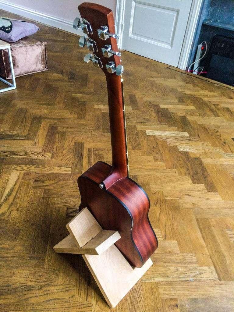 21. DIY Elegant Guitar Stand