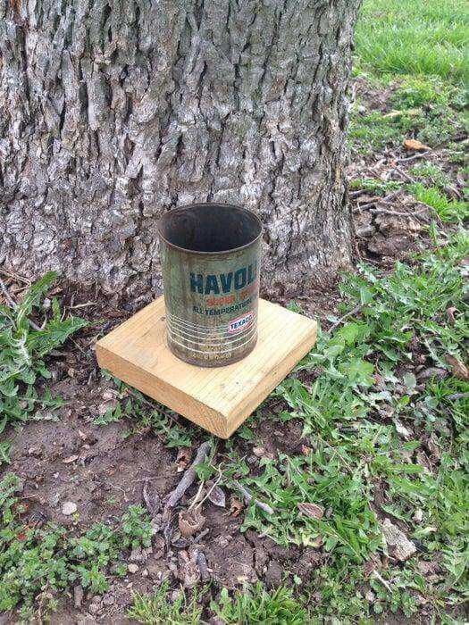 22. DIY Oil Can Squirrel Feeder