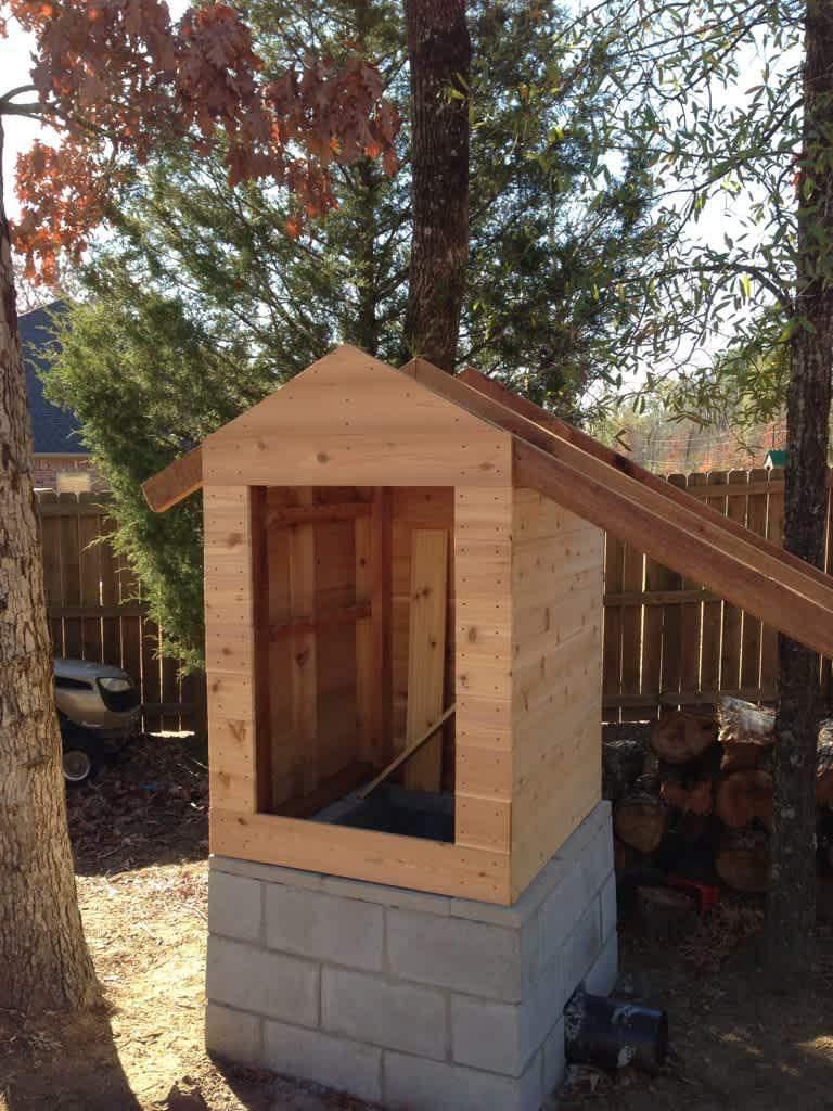14. DIY Backyard Smokehouse Plan