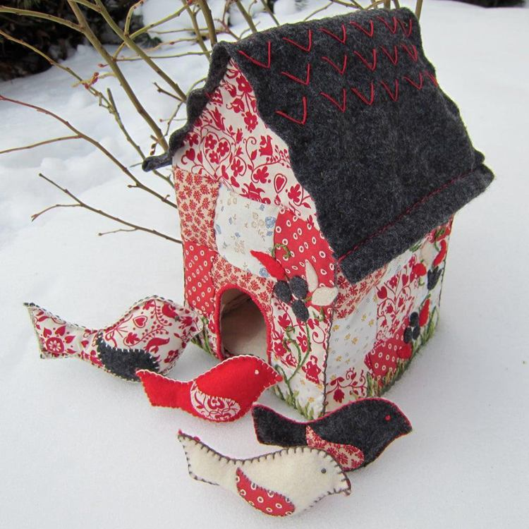 14. Quilted Bird House With Toy Bird Rattles