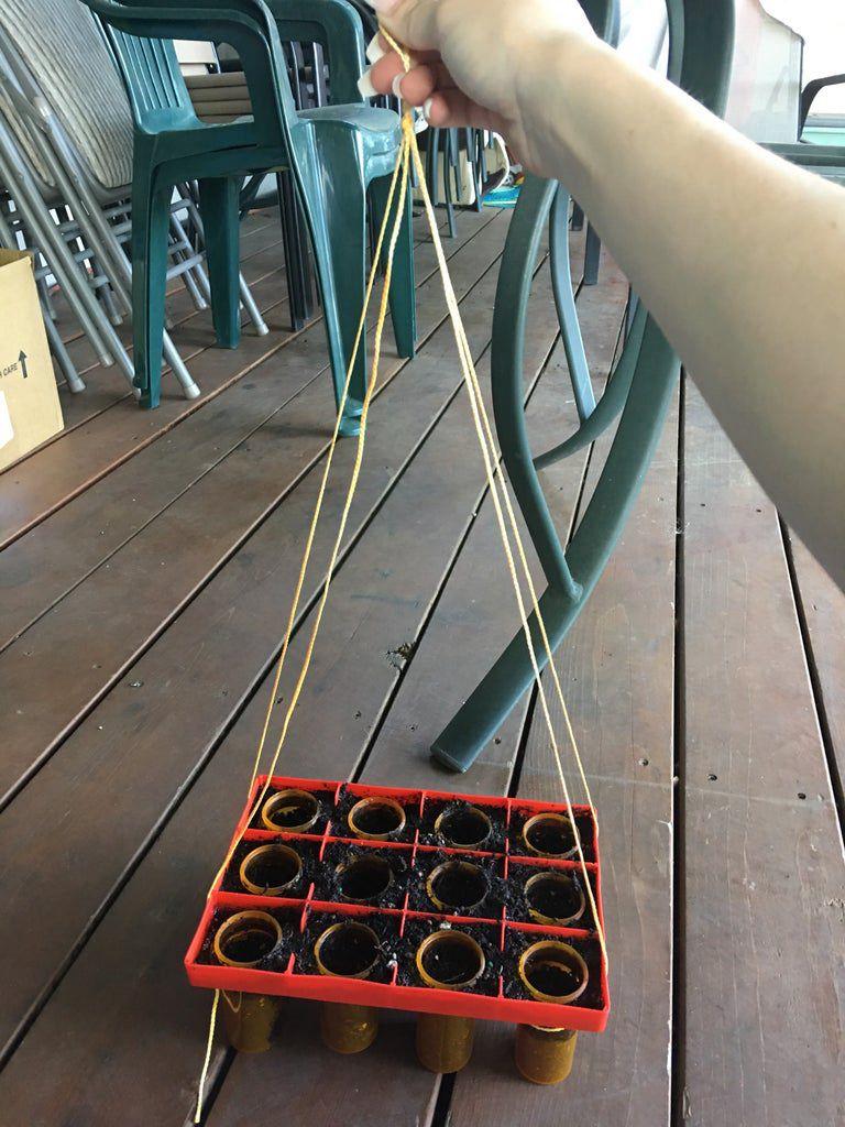 8. DIY Hanging Recycled Herb Garden