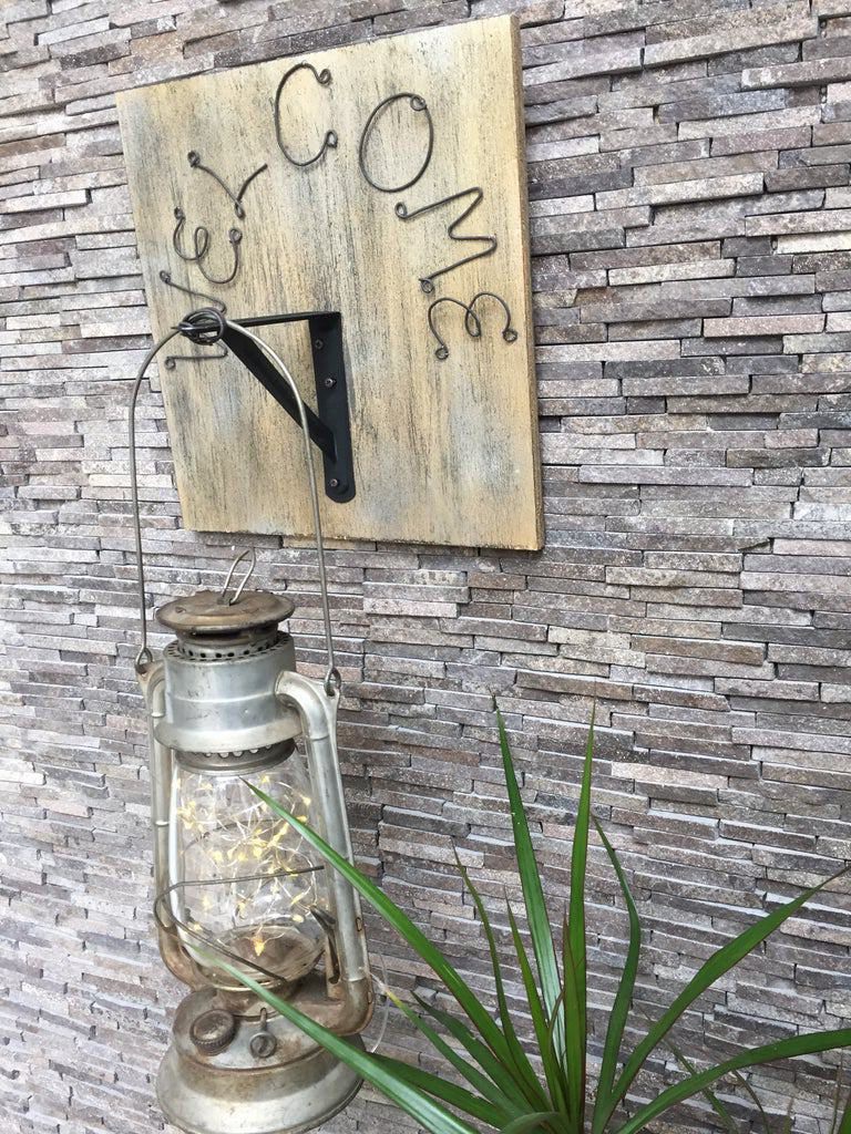 10. DIY Warming Welcome Sign