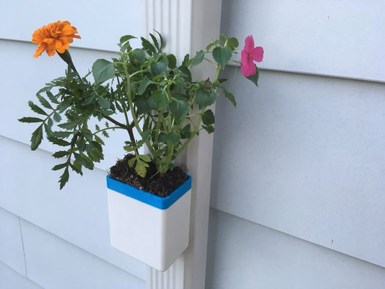 20. Self Watering Downspout Planter