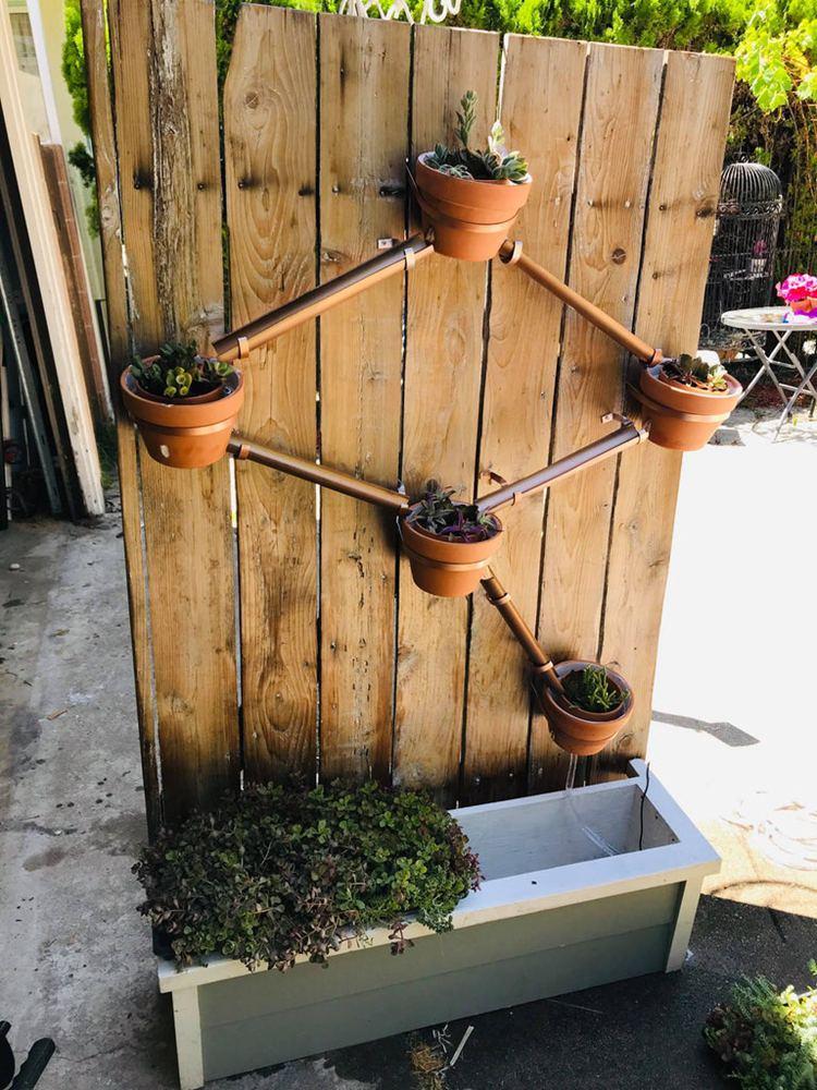 25. Circulating Self Watering Vertical Planter
