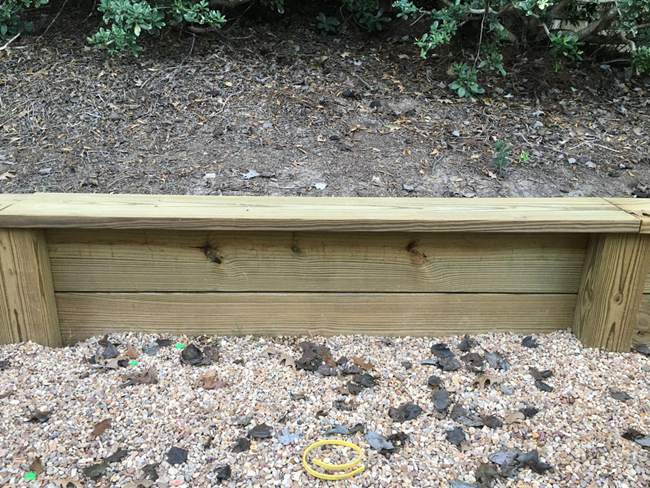 7. DIY Outdoor Wooden Retaining Wall